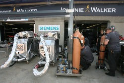 McLaren team members get ready for the race