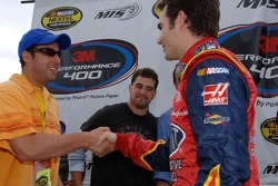 Actor Adam Sandler meets Jeff Gordon while Josh Gracin, American Idol contestant, looks on