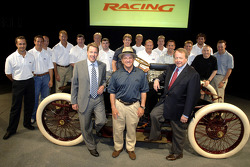 Bill Ford and Edsel Ford with Ford's NASCAR NEXTEL Cup and Craftsman Truck drivers and owners gather around Sweepstakes, Ford's first race car