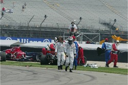 Juan Pablo Montoya and Kimi Raikkonen walk away from the crash