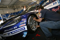 Crew member prepares Michelin tires