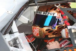 Tony Stewart adjust his helmet before qualifying