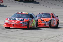 Jeff Gordon leads Jeff Burton into the pitlane for a pit stop