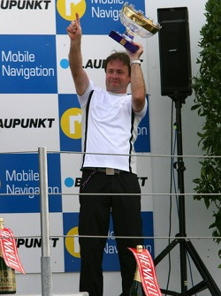 Podium: Gerhard Ungar, Chief Designer AMG, with the trophy for the winning constructor