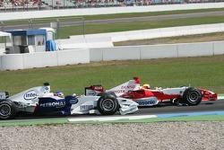 Ralf Schumacher and Jacques Villeneuve collide on the first lap