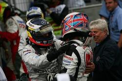 Race winner Jenson Button celebrates with Pedro de la Rosa