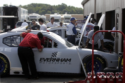 Evernham Motorsports team members work on one of their Dodge Chargers