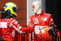 Pole winner Felipe Massa celebrates with Michael Schumacher