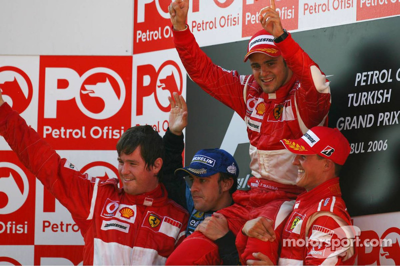 Podium: race winner Felipe Massa with Fernando Alonso, Michael Schumacher and Rob Smedly