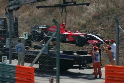 Tiago Monteiro's Midland Toyota M16 is loaded onto a lorry