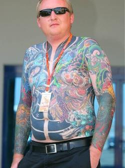 A man with many tatoo's