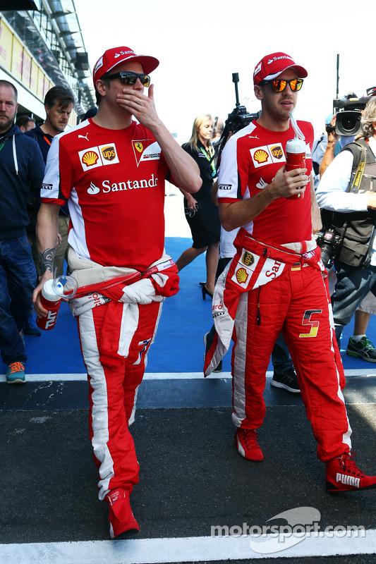 (da sinistra a destra): Kimi Raikkonen, Scuderia Ferrari con Sebastian Vettel, Scuderia Ferrari
