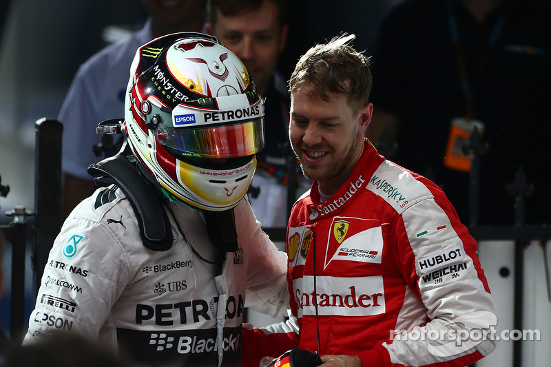 Race winner Lewis Hamilton, Mercedes AMG F1 W06 and third place Sebastian Vettel, Ferrari
