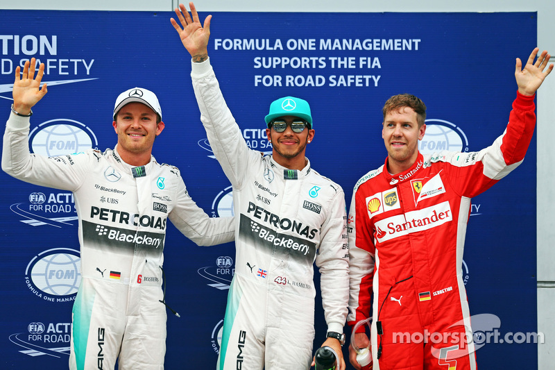 Qualifying top three in parc ferme (L to R): polesitter Lewis Hamilton, Mercedes AMG F1, second plac