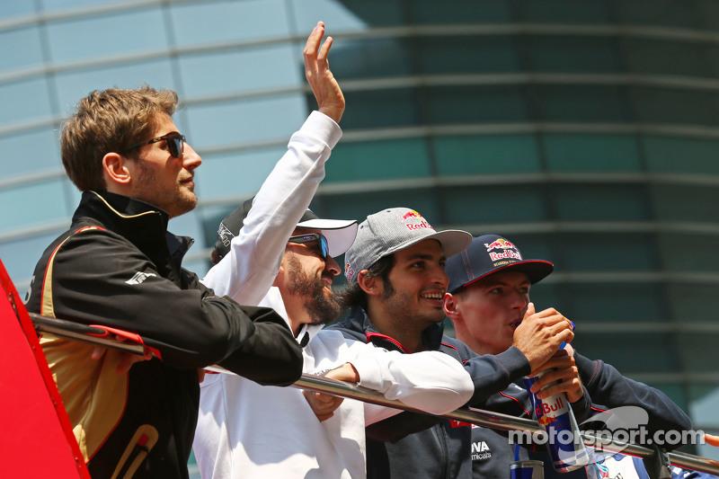 Romain Grosjean, Lotus F1 Team; Fernando Alonso, McLaren; Carlos Sainz Jr., Scuderia Toro Rosso; and Max Verstappen, Scuderia Toro Rosso on the drivers parade