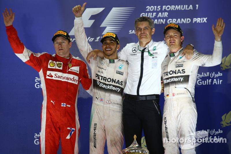 Podium: second place Kimi Raikkonen, Ferrari and winner Lewis Hamilton and second place Nico Rosberg