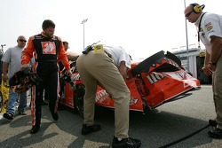 Tony Stewart checks over the damage on his Home Depot Chevy
