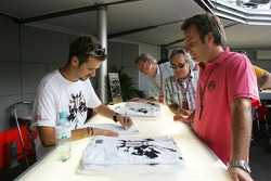 Tiago Monteiro signs his Monza edition t-shirt
