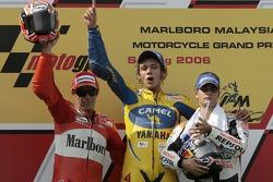 Podium: race winner Valentino Rossi with Loris Capirossi and Dani Pedrosa