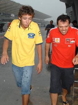 Valentino Rossi and Loris Capirossi in the rain