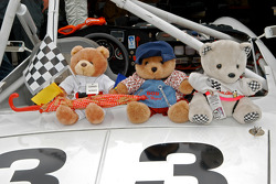 The crew of bears sit on their 1967 Datsun 2000 rdstr
