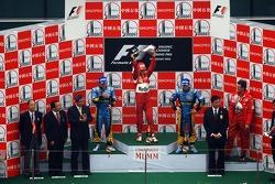 Podium: race winner Michael Schumacher with Fernando Alonso and Giancarlo Fisichella