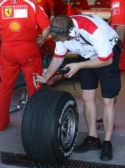 A bridgestone engineer checks the tyres