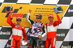 Podium: second place Loris Capirossi, 2006 MotoGP World Champion Nicky Hayden, and race winner Troy