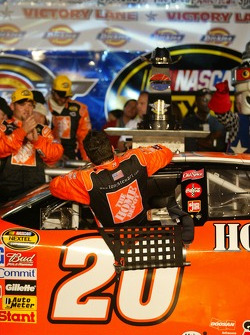 Victory lane: race winner Tony Stewart climbs out of his car