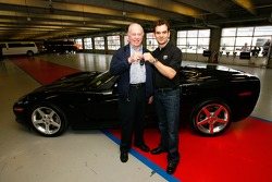 Benny Callis excepts the keys to Jeff Gordon's 2005 Corvette on behalf of his wife Norma Callis, who won the car in a raffle for the Jeff Gordon Foundation