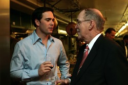 2006 NASCAR NEXTEL Cup Series champion, Jimmie Johnson, talks with NASCAR Vice President of Corporate Communications, Jim Hunter during the champion's welcome dinner at the Waldorf-Astoria Hotel