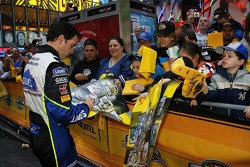 Jimmie Johnson signs autographs for NASCAR fans prior to Victory Lap in New York City