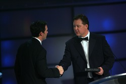Jimmie Johnson is presented with the 2006 NASCAR NEXTEL Cup Series championship ring by NASCAR Chairman and CEO Brian France