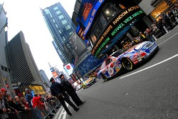 New York's finest keep control as Mark Martin starts his part of the Nextel Cup cars parade lap