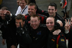 Jonny Reid's win is celebrated by his team mechanics