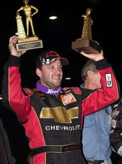 Tony Stewart added a second Golden Driller to his trophy collection by winning Saturday night's 50-lap O'Reilly Chili Bowl Midget Nationals championship finale
