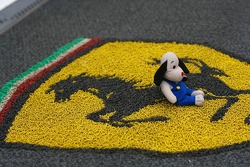 A toy on the ferrari hospitality door mat