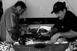 NAPA Toyota crew members prepare the backup car of Michael Waltrip