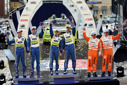 Podium: winners Mikko Hirvonen and Jarmo Lehtinen, second place Marcus Gronholm and Timo Rautiainen, third place Henning Solberg and Cato Menkerud