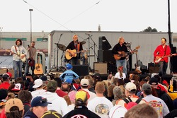 A view of the Kevin Costner Band with actor/singer Kevin Costner singing