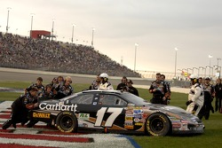 The Roush Racing crew push Matt Kenseth and the Ford Fusion to victory lane