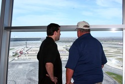 Tony Stewart and A.J. Foyt Jr. share a private moment overlooking Texas Motor Speedway