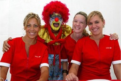 A clown with some girls
