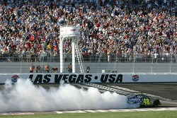 Race winner Jimmie Johnson performs a burnout on the track