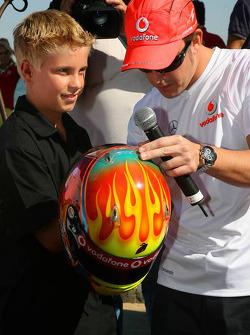 Fernando Alonso, McLaren Mercedes, meets young racing hopeful, Chris Hays - Vodafone and McLaren Mercedes event