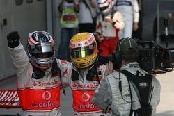 Race winner Fernando Alonso celebrates with Lewis Hamilton