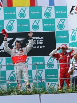 Podium: race winner Fernando Alonso with Kimi Raikkonen