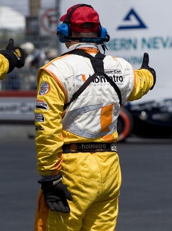 A Champ Car safety team member gives the thumb up to the drivers
