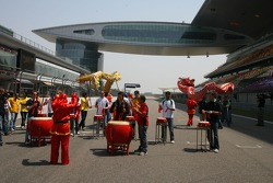 A1GP drivers playing the drums at the Shanghai circuit