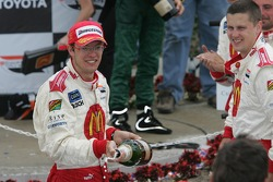 Podium: race winner Sébastien Bourdais sprays champagne